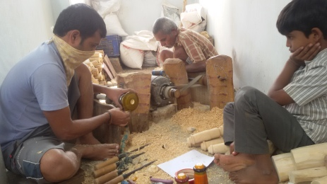 We went to the factory and saw this guys working hard at making wooden toys